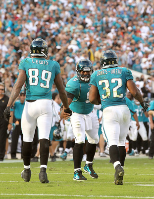 JACKSONVILLE, FL - NOVEMBER 21:  David Garrard #9  of the Jacksonville Jaguars congratulates Maurice Jones-Drew #32 after scoring a touchdown  during a game agaisnt the Cleveland Browns at EverBank Field on November 21, 2010 in Jacksonville, Florida.  (Ph