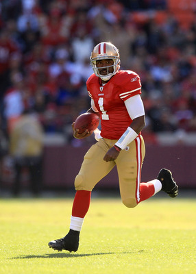 SAN FRANCISCO - NOVEMBER 21:  Troy Smith #1 of the San Francisco 49ers runs with the ball against the Tampa Bay Buccaneers at Candlestick Park on November 21, 2010 in San Francisco, California.  (Photo by Ezra Shaw/Getty Images)