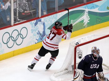 VANCOUVER, BC - FEBRUARY 28:  Sidney Crosby #87 of Canada starts to celebrate after scoring the game-winning goal in overtime against Ryan Miller #39 of USA  in the ice hockey men's gold medal game between USA and Canada on day 17 of the Vancouver 2010 Wi