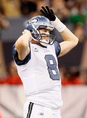 NEW ORLEANS - NOVEMBER 21:  Quarterback Matt Hasselbeck #8 of the Seattle Seahawks reacts after a turnover to the New Orleans Saints that was overturned into an incomplete pass on a coach's challenge at Louisiana Superdome on November 21, 2010 in New Orle