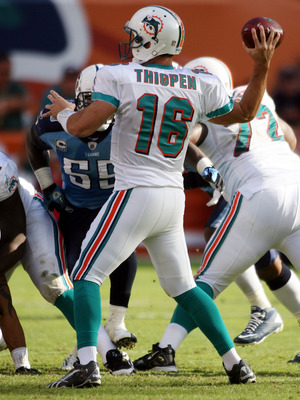 MIAMI - NOVEMBER 14:  Quarterback Tyler Thigpen #16 of the Miami Dolphins passes against the Tennessee Titans at Sun Life Stadium on November 14, 2010 in Miami, Florida.  (Photo by Marc Serota/Getty Images)