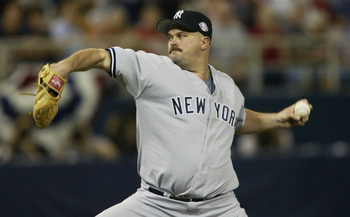 MINNEAPOLIS - OCTOBER 5:  Starting pitcher David Wells #33 of the New York Yankees pitches during the American League Division Series against the Minnesota Twins on October 5, 2003 at the Hubert H. Humphrey Metrodome in Minneapolis, Minnesota.  The Yankee