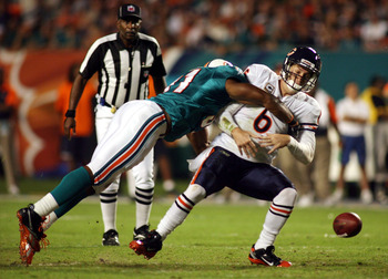 MIAMI - NOVEMBER 18:  Quarterback Jay Cutler #6 of the Chicago Bears is sacked by linebacker Cameron wake #91 of the Miami Dolphins and fumbles at Sun Life Stadium on November 18, 2010 in Miami, Florida.  (Photo by Marc Serota/Getty Images)