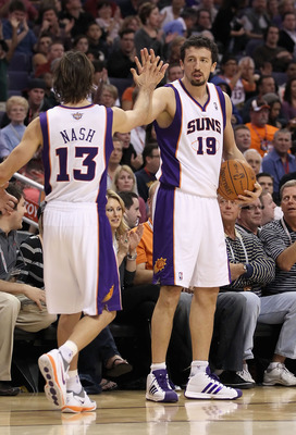PHOENIX - NOVEMBER 15:  Hedo Turkoglu #19 of the Phoenix Suns high fives teammate Steve Nash #13 during the NBA game against the Denver Nuggets at US Airways Center on November 15, 2010 in Phoenix, Arizona. The Suns defeated the Nuggets 100-94. NOTE TO US