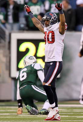 EAST RUTHERFORD, NJ - NOVEMBER 21:  Jason Allen #30 of the Houston Texans celebrates after Mark Sanchez #6 of the New York Jets threw a fourth quarter interception on November 21, 2010 at the New Meadowlands Stadium in East Rutherford, New Jersey. The Jet