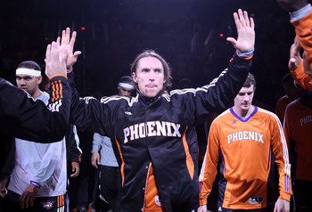 PHOENIX - OCTOBER 12:  Steve Nash #13 of the Phoenix Suns high fives teamamtes as he is introduced before the preseason NBA game against the Utah Jazz at US Airways Center on October 12, 2010 in Phoenix, Arizona. NOTE TO USER: User expressly acknowledges