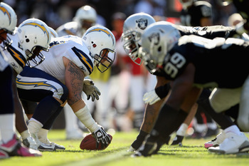 OAKLAND, CA - OCTOBER 10:  Nick Hardwick #61 at center and the rest of the San Diego Chargers line up against the Oakland Raiders at Oakland-Alameda County Coliseum on October 10, 2010 in Oakland, California.  (Photo by Ezra Shaw/Getty Images)