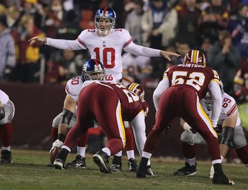 LANDOVER, MD - DECEMBER 21:  Eli Manning #10 of the New York Giants in action against the Washington Redskins during their game on December 21, 2009 at Fedex Field in Landover, Maryland.  (Photo by Al Bello/Getty Images)