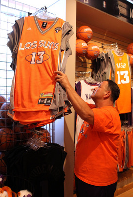 PHOENIX - MAY 05:  Phoenix Suns fan Marc Lyles purchases a 'Los Suns' jersey before Game Two of the Western Conference Semifinals of the 2010 NBA Playoffs against the San Antonio Spurs at US Airways Center on May 5, 2010 in Phoenix, Arizona. The team is w