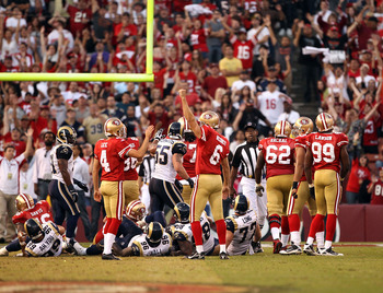 SAN FRANCISCO - NOVEMBER 14:  Joe Nedney #6 of the San Francisco 49ers celebrates after he kicked the winning field goal in overtime against the St. Louis Rams at Candlestick Park on November 14, 2010 in San Francisco, California.  (Photo by Ezra Shaw/Get