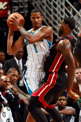 NEW ORLEANS - NOVEMBER 05:  Trevor Ariza #1 of the New Orleans Hornets looks to pass the ball around LeBron James #6 of the Miami Heat at the New Orleans Arena on November 5, 2010 in New Orleans, Louisiana.  NOTE TO USER: User expressly acknowledges and a