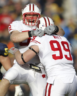 ANN ARBOR, MI - NOVEMBER 20:  J.J. Watt #99 of the Wisconsin Badgers celebrates a fourth quarter interception with Patrick Butrym #95 while playing the Michigan Wolverines at Michigan Stadium on November 20, 2010 in Ann Arbor, Michigan. Wisconson won the