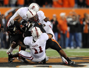CORVALLIS, OR - OCTOBER 10: Running back Jacquizz Rodgers #1 of the Oregon State Beavers is tackled by linebacker Shayne Skov #11 and cornerback Richard Sherman #9 of Stanford Cardinals in the third quarter of the game at Reser Stadium on October 10, 2009