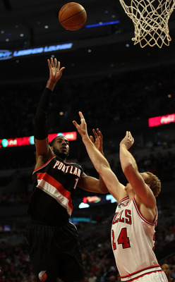 CHICAGO - NOVEMBER 01: LaMarcus Aldridge #12 of the Portland Trail Blazers puts up a shot over Brian Scalabrine #24 of the Chicago Bulls at the United Center on November 1, 2010 in Chicago, Illinois. The Bulls defeated the Trail Blazers 110-98. NOTE TO US