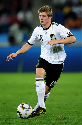 DURBAN, SOUTH AFRICA - JULY 07:  Toni Kroos of Germany runs with the ball during the 2010 FIFA World Cup South Africa Semi Final match between Germany and Spain at Durban Stadium on July 7, 2010 in Durban, South Africa.  (Photo by Clive Mason/Getty Images