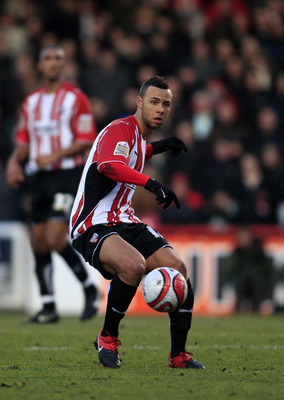 LONDON, ENGLAND - DECEMBER 28:  John Bostock of Brentford during the Coca Cola League One match between Brentford and Charlton Athletic at Griffin Park on December 28, 2009 in London, England. (Photo by Jed Leicester/Getty Images)
