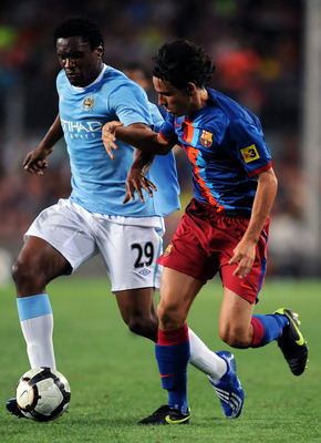 BARCELONA, SPAIN - AUGUST 19:  Gai (R) of Barcelona duels for the ball with Kelvin Etuhu of Manchester City during the Joan Gamper Trophy match between Barcelona and Manchester City at the Camp Nou Stadium on August 19, 2009 in Barcelona, Spain. Mancheste