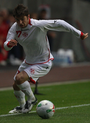 SWANSEA, UNITED KINGDOM - AUGUST 20:  Levan Kenia of Georgia in action during the International Friendly match between Wales and Georgia at The Liberty Stadium on August 20, 2008 in Swansea, Wales.  (Photo by Hamish Blair/Getty Images)