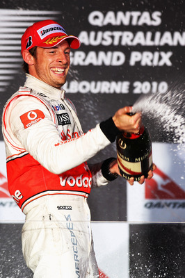MELBOURNE, AUSTRALIA - MARCH 28:  Jenson Button of Great Britain and McLaren Mercedes celebrates winning the the Australian Formula One Grand Prix at the Albert Park Circuit on March 28, 2010 in Melbourne, Australia.  (Photo by Mark Thompson/Getty Images)