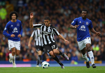 LIVERPOOL, ENGLAND - SEPTEMBER 18:  Hatem Ben Arfa of Newcastle United beats Yakubu of Everton during the Barclays Premier League match between Everton and Newcastle United at Goodison Park on September 18, 2010 in Liverpool, England.  (Photo by Alex Live