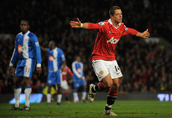 MANCHESTER, ENGLAND - NOVEMBER 20:  Javier Hernandez of Manchester United celebrates scoring his team's 2-0 goal during the Barclays Premier League match between Manchester United and Wigan Athletic at Old Trafford on November 20, 2010 in Manchester, Engl
