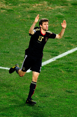 PORT ELIZABETH, SOUTH AFRICA - JULY 10:  Thomas Mueller of Germany celebrates scoring the opening goal during the 2010 FIFA World Cup South Africa Third Place Play-off match between Uruguay and Germany at The Nelson Mandela Bay Stadium on July 10, 2010 in