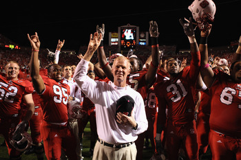 RALEIGH, NC - OCTOBER 28:  Head coach Tom O'Brien of the North Carolina State Wolfpack celebrates with his team after defeating the Florida State Seminoles 28-24 during their game at Carter-Finley Stadium on October 28, 2010 in Raleigh, North Carolina.  (