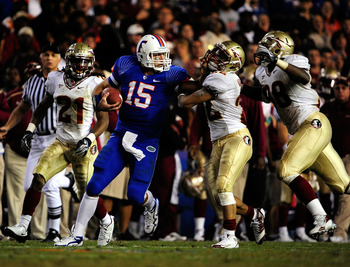 GAINESVILLE, FL - NOVEMBER 28:  Tim Tebow #15 of the Florida Gators runs past Cory Mangum #22 of the Florida State Seminoles at Ben Hill Griffin Stadium on November 28, 2009 in Gainesville, Florida.  (Photo by Sam Greenwood/Getty Images)