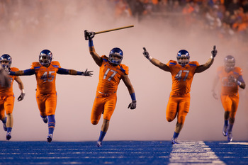 BOISE, ID - NOVEMBER 19:  Winston Venable #17 leads the Boise State Broncos onto the field before their game against the Fresno State Bulldogs at Bronco Stadium on November 19, 2010 in Boise, Idaho.  (Photo by Otto Kitsinger III/Getty Images)