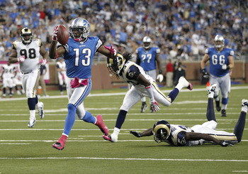 DETROIT - OCTOBER 10: Nate Burleson #13 of the Detroit Lions gets past the St. Louis Rams defense for a third quarter touchdown on October 10, 2010 at Ford Field in Detroit, Michigan. Detroit won the game 44-6. (Photo by Gregory Shamus/Getty Images)