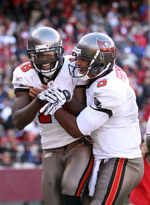 SAN FRANCISCO - NOVEMBER 21:  Mike Williams #19 of the Tampa Bay Buccaneers is congratulated by Josh Freeman #5 after he scored a touchdown against the San Francisco 49ers at Candlestick Park on November 21, 2010 in San Francisco, California.  (Photo by E