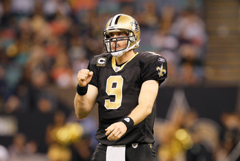NEW ORLEANS - NOVEMBER 21:  Quarterback Drew Brees #9 of the New Orleans Saints reacts after a first down against the Seattle Seahawks at Louisiana Superdome on November 21, 2010 in New Orleans, Louisiana.  (Photo by Kevin C. Cox/Getty Images)