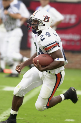 GEORGIA, ATLANTA - SEPTEMBER 6:  Running back Carnell Williams #24 of the Auburn Tigers runs with the ball during the game against the Georgia Tech Yellow Jackets on September 6, 2003 at Bobby Dodd Stadium/Grant Field in Atlanta, Georgia. The Yellow Jacke