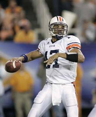 ATLANTA, GA - DECEMBER 4:  Quarterback Jason Campbell #17 of the Auburn Tigers looks to pass against defensive end Parys Haralson #98 and the Tennessee Volunteers during the 2004 SEC Championship Game at the Georgia Dome on December 4, 2004 in Atlanta, Ge