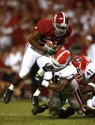 TUSCALOOSA, AL - SEPTEMBER 22:  Defensive end Marcus Howard #38 of the Georgia Bulldogs brings down running back Glen Coffee #38 of the Alabama Crimson Tide at Bryant-Denny Stadium September 22, 2007 in Tuscaloosa, Alabama. Georgia defeated Alabama 26-23