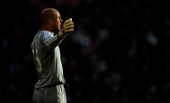 LIVERPOOL, ENGLAND - OCTOBER 24:  Pepe Reina of Liverpool gestures during the Barclays Premier League match between Liverpool and Blackburn Rovers at Anfield on October 24, 2010 in Liverpool, England. (Photo by Michael Regan/Getty Images)