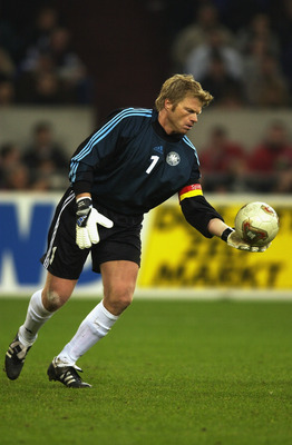 GELSENKIRCHEN- NOVEMBER 20:  Oliver Kahn of Germany with the ball in his hand preparing to kick it during the international friendly between Germany and Holland held on November 20, 2002 at The Auf Schalke Arena, Gelsenkirchen, Germany.  Holland won the m