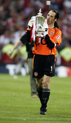 CARDIFF - MAY 17:  David Seaman of Arsenal celebrates with the FA Cup after winning the FA Cup Final match between Arsenal and Southampton on May 17, 2003 at the Millennium Stadium in Cardiff, Wales. David Seaman, who was capped 75 times for England, anno