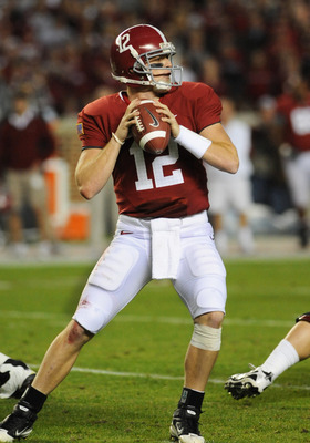 TUSCALOOSA, AL - NOVEMBER 13: Quarterback Greg McElroy #12 of the Alabama Crimson Tide sets to pass against the Mississippi State Bulldogs November 13, 2010 at Bryant-Denny Stadium in Tuscaloosa, Alabama.  (Photo by Al Messerschmidt/Getty Images)