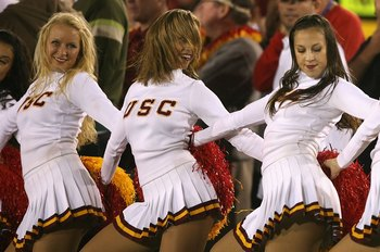 LOS ANGELES, CA - NOVEMBER 03:  The USC Trojans song girls, (L-R) Sara, Jenny and Diana perform during the college football game against the Oregon State Beavers at the Los Angeles Memorial Coliseum on November 3, 2007 in Los Angeles, California. USC defe