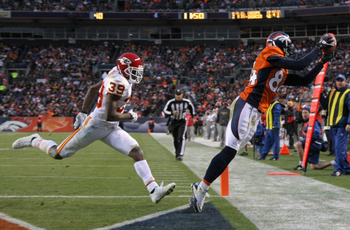 DENVER - NOVEMBER 14:  Wide receiver Brandon Lloyd #84 of the Denver Broncos makes a touchdown reception in fourth quarter as Brandon Carr #39 of the Kansas City Chiefs defends at INVESCO Field at Mile High on November 14, 2010 in Denver, Colorado. The pl