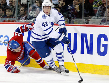 MONTREAL - NOVEMBER 20:  Tyler Bozak #42 of the Toronto Maple Leafs skates with the puck while being chased by Josh Gorges #26 of the Montreal Canadiens during the NHL game at the Bell Centre on November 20, 2010 in Montreal, Quebec, Canada.  (Photo by Ri