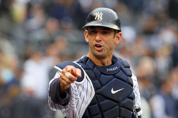 NEW YORK - OCTOBER 20:  Jorge Posada #20 of the New York Yankees gestures towards the dugout against the Texas Rangers in Game Five of the ALCS during the 2010 MLB Playoffs at Yankee Stadium on October 20, 2010 in the Bronx borough of New York City.  (Pho