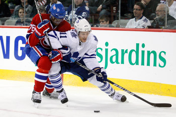 MONTREAL - NOVEMBER 20:  Fredrik Sjostrom #11 of the Toronto Maple Leafs stick handles the puck while being defended by P.K. Subban #76 of the Montreal Canadiens during the NHL game at the Bell Centre on November 20, 2010 in Montreal, Quebec, Canada.  (Ph