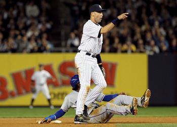 NEW YORK - OCTOBER 20:  Derek Jeter #2 of the New York Yankees reacts after he tagged out Elvis Andrus #1 of the Texas Rangers on a pickoff play at second base in the top of the seventh inninng of Game Five of the ALCS during the 2010 MLB Playoffs at Yank