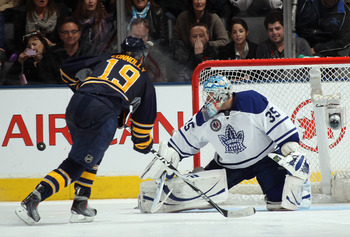 TORONTO, ON - NOVEMBER 06:  Jean-Sebastien Gigure #35 of the Toronto Maple Leafs stops Tim Connolly #19 of the Buffalo Sabres during the shoot out at the Air Canada Centre on November 6, 2010 in Toronto, Canada.  (Photo by Bruce Bennett/Getty Images)