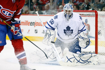 MONTREAL - NOVEMBER 20:  Jonas Gustavsson #50 of the Toronto Maple Leafs watches the incoming puck during the NHL game against the Montreal Canadiens at the Bell Centre on November 20, 2010 in Montreal, Quebec, Canada.  (Photo by Richard Wolowicz/Getty Im