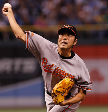 ST. PETERSBURG, FL - SEPTEMBER 29:  Relief pitcher Koji Uehara #19 of the Baltimore Orioles pitches against the Tampa Bay Rays at Tropicana Field on September 29, 2010 in St. Petersburg, Florida.  (Photo by J. Meric/Getty Images)