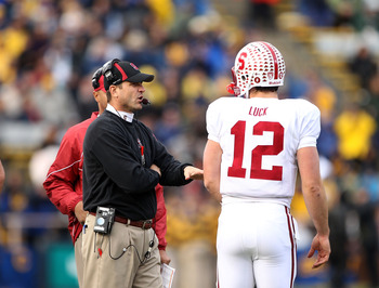 BERKELEY, CA - NOVEMBER 20:  Head coach Jim Harbaugh talks to Andrew Luck #12 during their game against the California Golden Bears at California Memorial Stadium on November 20, 2010 in Berkeley, California.  (Photo by Ezra Shaw/Getty Images)