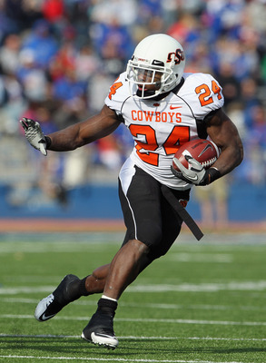 LAWRENCE, KS - NOVEMBER 20:  Running back Kendall Hunter #24 of the Oklahoma State Cowboys carries the ball during the game against the Kansas Jayhawks on November 20, 2010 at Memorial Stadium in Lawrence, Kansas.  (Photo by Jamie Squire/Getty Images)